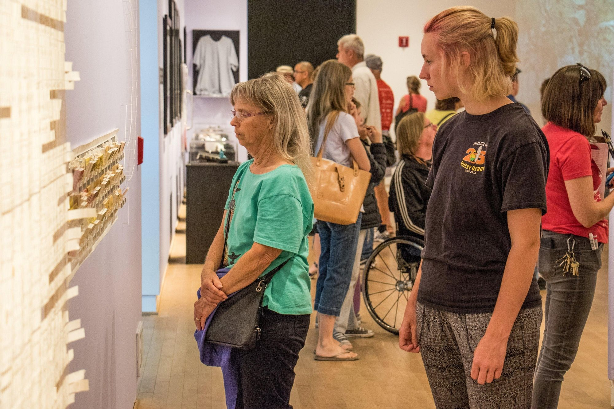 People looking at exhibition element.